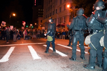 Riot squad facing protesters