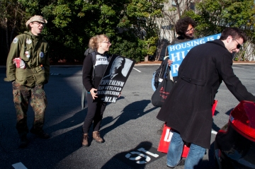 Daniel Hanley distributing protest signs to Walkupiers