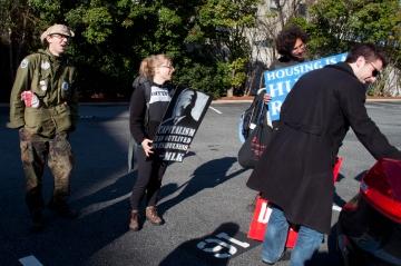 Daniel Hanley distributing protest signs to Walkupiers