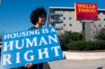 Peter Grotticelli holding sign in front of Wells Fargo