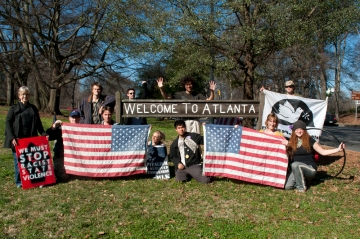 Walkupiers and Occupy Atlanta supporters in front of Welcome to Atlanta sign