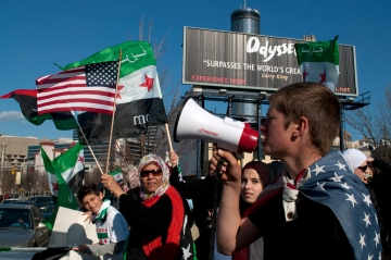 Kid with Syrian protesters at the CNN building