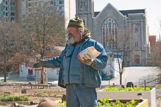 Duane Marcus Holding a Bag of Holly-tone Fertilizer | Nexus