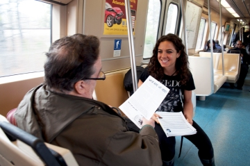 Train rider expressing support for petition