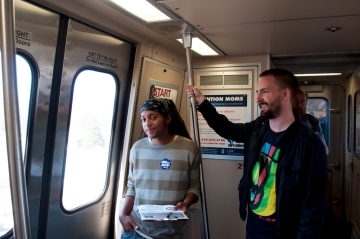 Donnell and Joey in MARTA train for outreach action