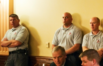 Unfriendly faces from law enforcement dive team in the gallery