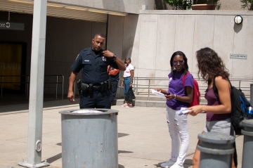 Policeman expelling Misty Novitch from Marta station entrance