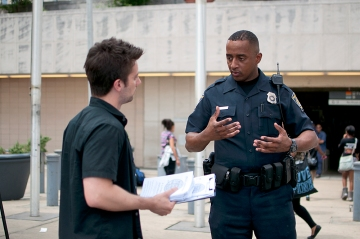 Policeman explaining restrictions at Marta station