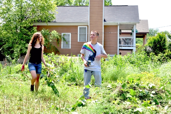 Lulu and Charlie pulling weeds