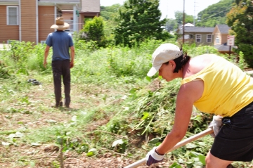 Sally Mason raking weeds