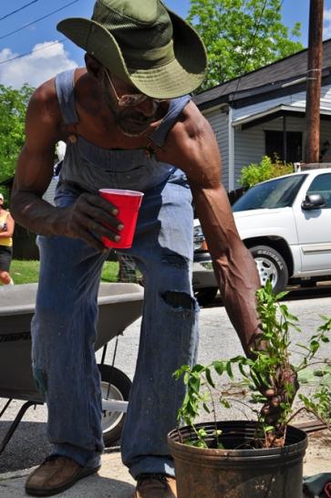 Vine City gardener JR bringing peppermint to transplant